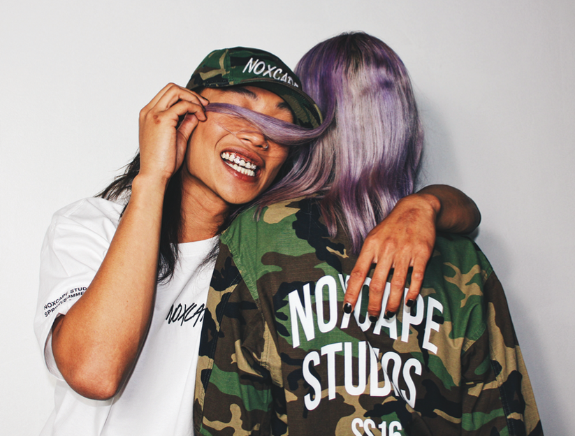 Army Jacket, 5-Panel Camo (Hat), and White (tee shirt) modeled by Henderson Nguyen and Sara Haj Ali Akbari, photo by Anand Sheth