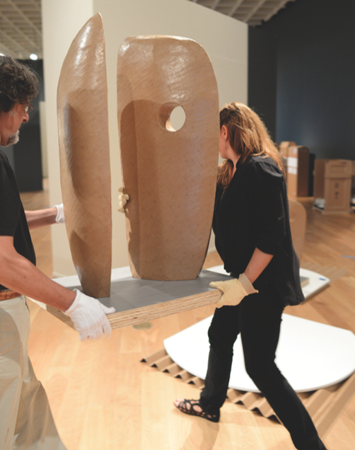 Ginger and Rick Birkbeck installing Terence Gower's piece